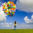 Jumping with balloons - Stock Photo