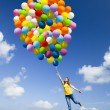 Jumping with balloons — Stock Photo