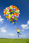 Jumping with balloons — Photo