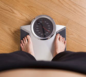 Measuring weight — Stockfoto
