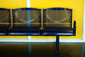 Seats with yellow backgroud — Foto Stock