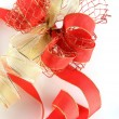 Shiny red and gold ribbon bow — Stock Photo