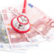 Foto Stock: Stethoscope and money