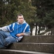 Young man sitting — Stock Photo