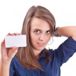 Young woman pointing at blank card in her hand — Stock Photo #6871632