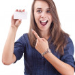 Young woman pointing at blank card in her hand — Stock Photo #6871642