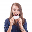 Surprised young woman looking at a blank card — Stock Photo