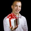 Man with a wrapped gift box — Stock Photo