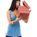 Woman looking at a gift box — Stock Photo