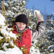 Young man playing with snowball — Stock fotografie #6871809