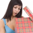 Woman opening the gift — Stockfoto