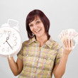 Woman holding clock and money — Stock Photo #6872183