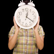 Woman holding clock — Stock Photo #6872194