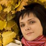 Woman on the autumn leaf — Stock Photo #6872232