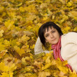Woman on the autumn leaf — Stock Photo #6872251