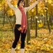Woman on the autumn leaf — Stock Photo #6872253