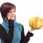 Girl and pumpkin — Stock Photo