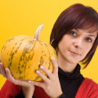 Stock Photo: Girl and pumpkin
