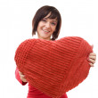 Woman with red heart-shaped pillow — Stock Photo
