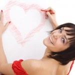 Woman drawing heart-shape — Stock Photo