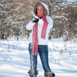 Woman playing with snowballs — Stockfoto