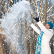 Woman throwing some snow — Stock Photo