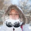 Woman blowing snow — Stock Photo #6872519