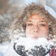 Woman blowing snow — Stockfoto #6872528