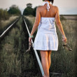 Woman on the railway — Stock Photo