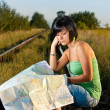 Girl looking on the map — Stock Photo