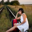 Standing along the rail — Stock Photo