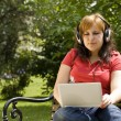 Woman listening to music — Stock Photo #6872834