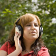 Woman listening to music — Stock Photo #6872885