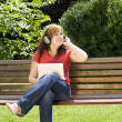 Woman listening to music — Stock Photo #6872893