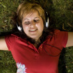 Woman listening to music — Stock Photo #6872937