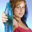 Woman with bottle — Stock Photo
