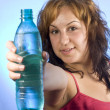 Woman with bottle of water — Stock Photo