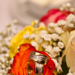 Wedding rings and roses — Stock Photo #6873256
