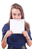 Cute young woman showing a blank board — Foto Stock