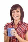 Woman with cup of tea — Stockfoto