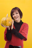 Girl and pumpkin — Stock Photo