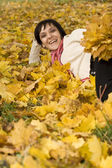 Woman on the autumn leaf — Stock Photo