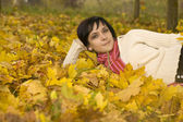 Woman on the autumn leaf — Stock Photo
