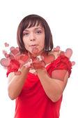 Woman blowing heart — Stock Photo