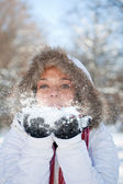 Woman blowing snow — Photo