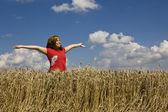 Woman in field — Stock Photo