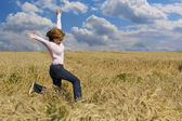 Woman in field — Foto de Stock