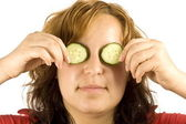 Woman and cucumber — Stockfoto
