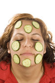 Woman and cucumber — Stock Photo