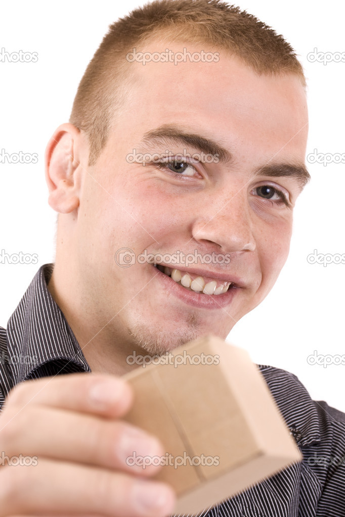Young man with a wrapped a little gift box for you  Stock Photo #6871692